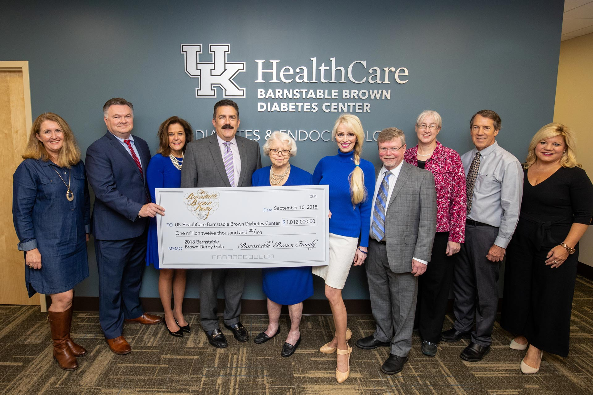 A check presentation inside the UK HealthCare Barnstable Brown Diabetes Center. Representatives of the Barnstable-Brownfamily present a check for $1.02 million, raised during the 2018 Barnstable-Brown Gala, to Dr. Mark Newman, Executive VP of Health Affairs at UK HealthCare.