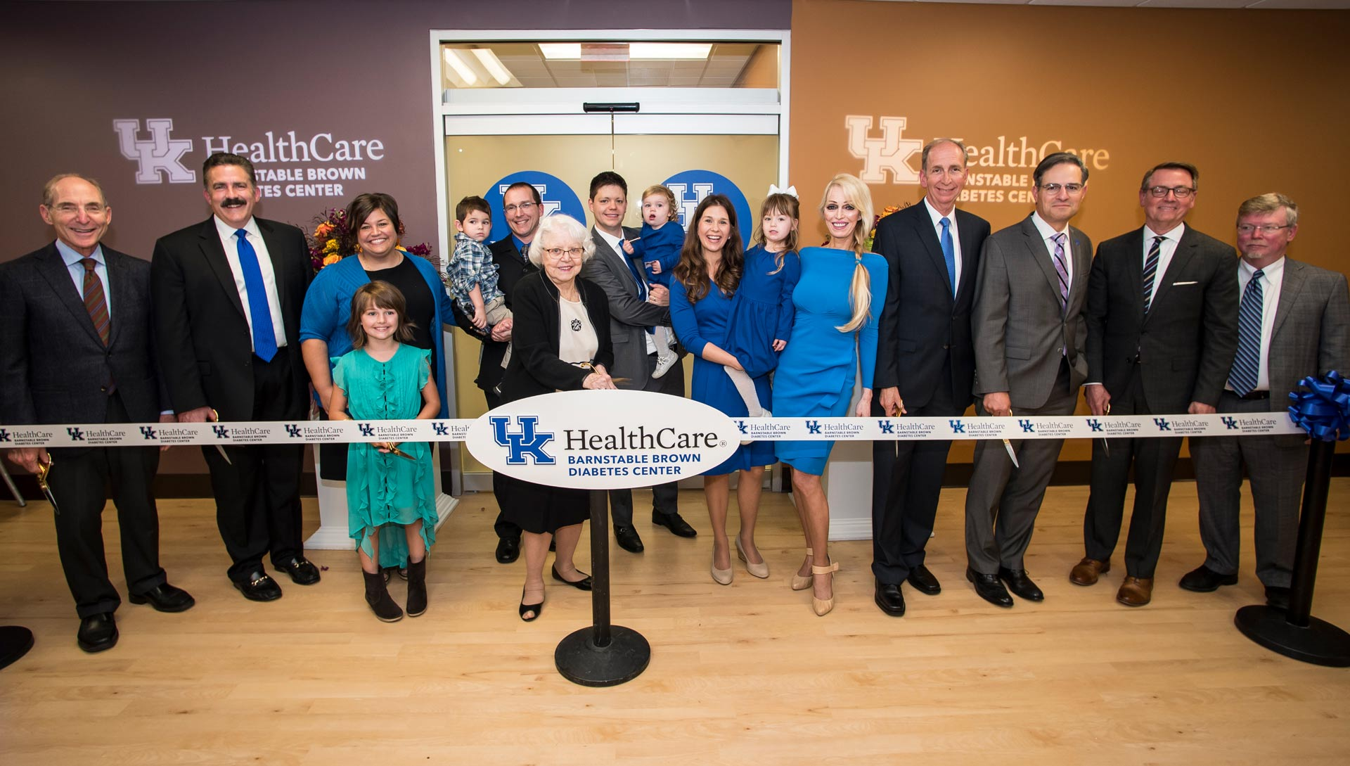 A group of people, including members of UK, UK HealthCare, and the Barnstable-Brown family, pose for a photo at the ribbon-cutting ceremony for the expanded UK HealthCare Barnstable Brown Diabetes Center.