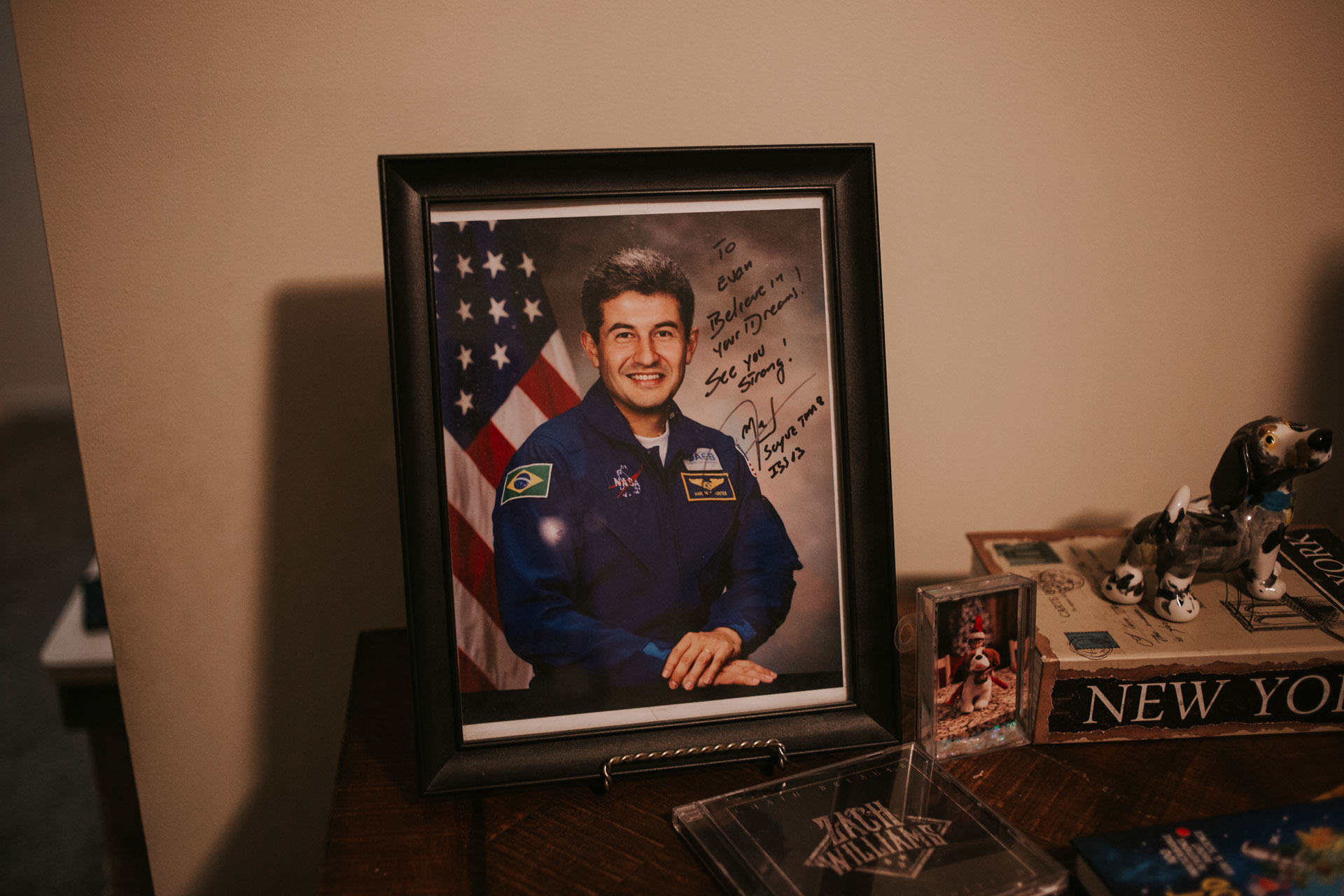 A signed and framed image from NASA of Astronaut Marcos Pontes to Evan.