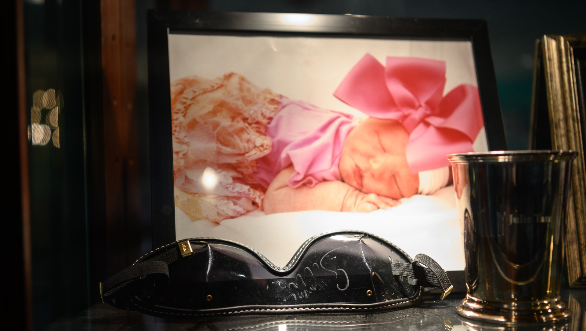 A framed photograph of Julie as a newborn.