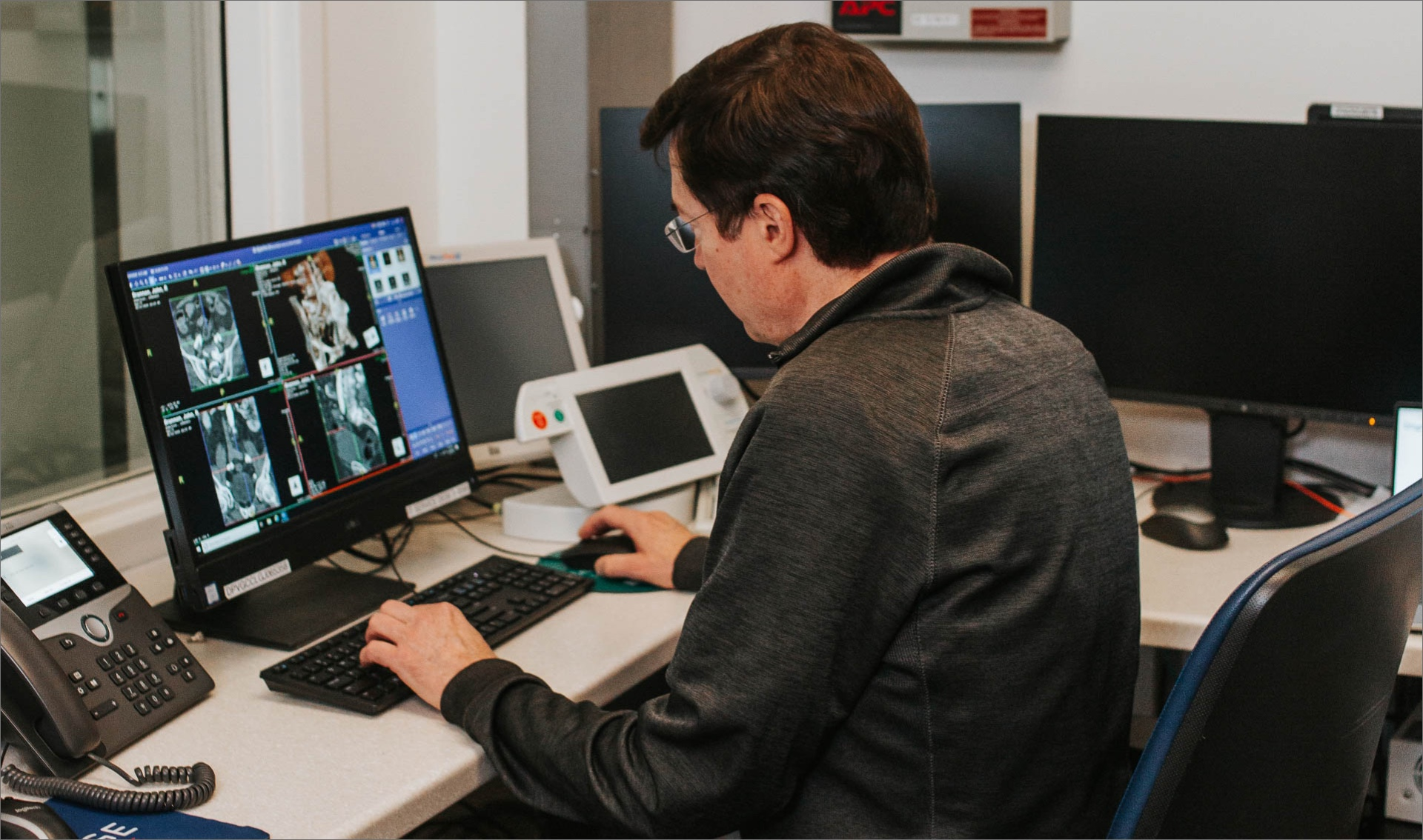 Dr. Gurley works at a computer, looking at scans.