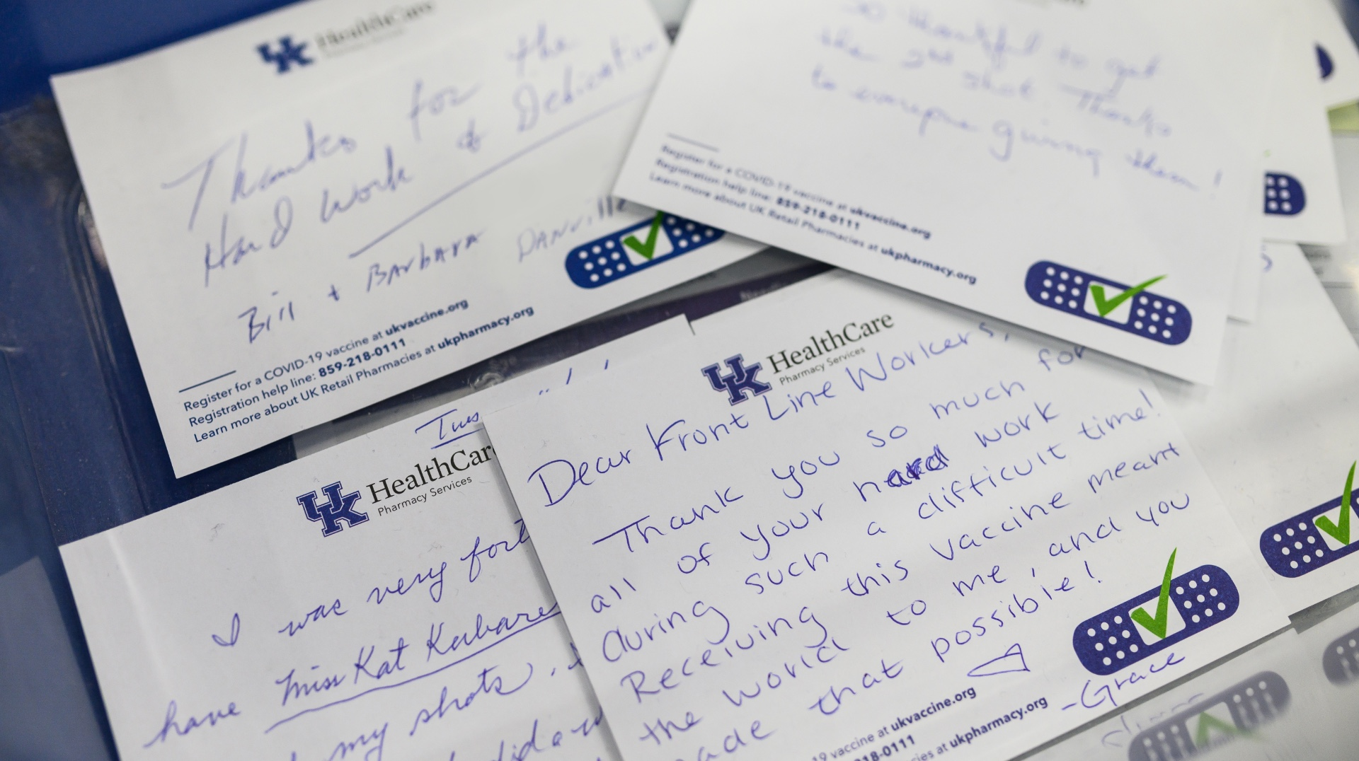 A table of thank-you notes from a grateful community of vaccinated people.