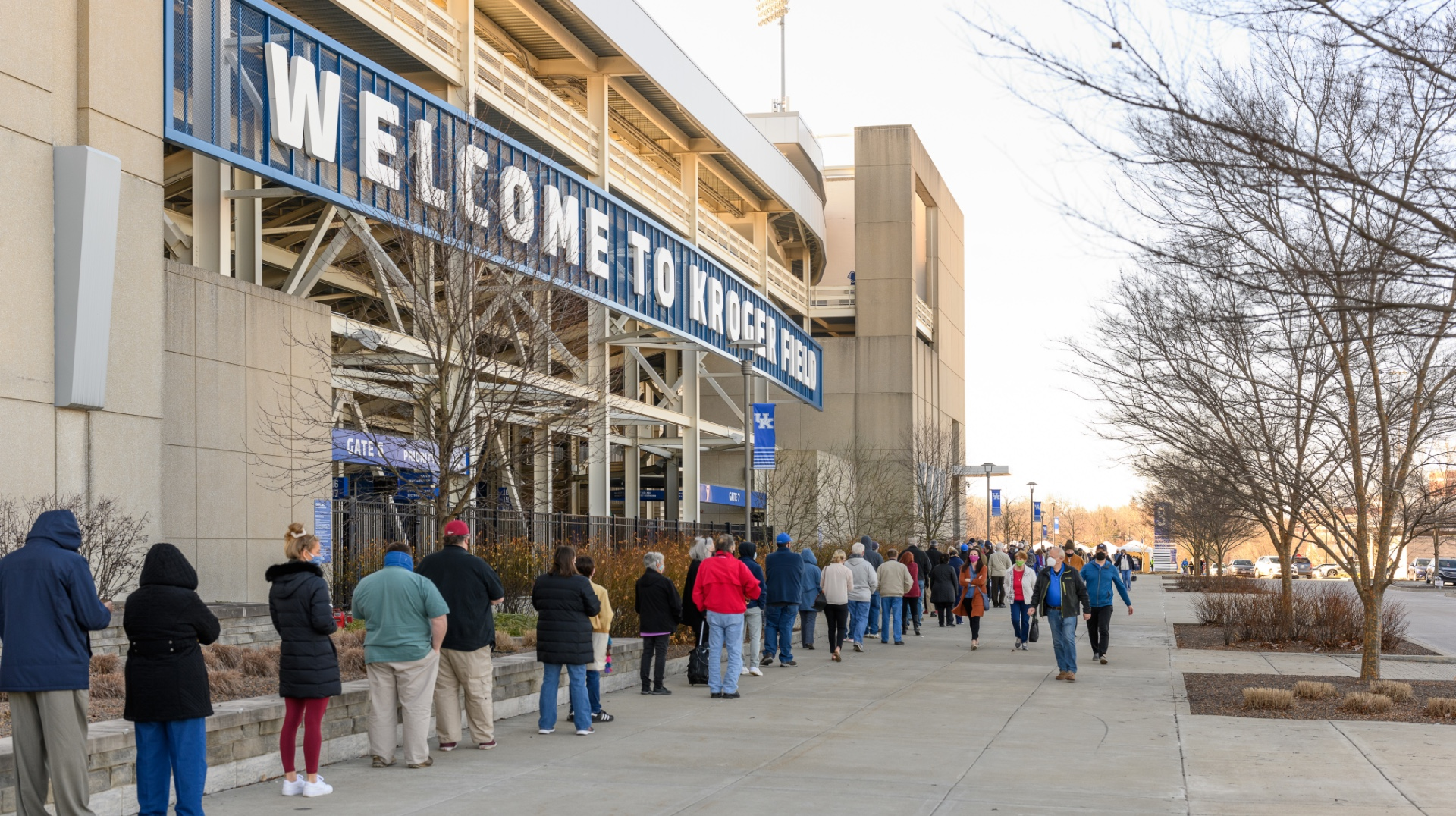 A long line of people outside of the Kroger Field Stadium waiting to get the COVID-19 vaccine.